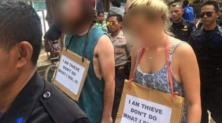 Tourists paraded in 'walk of shame' over theft